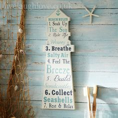 Lighthouse Wooden Sign - Beach Rules:  £6.95  http://www.livelaughlove.co.uk/Lighthouse-Wooden-Sign-Beach-Rules.html  This wooden lighthouse shaped plaque will give you a list of beach rules ready for the summertime.