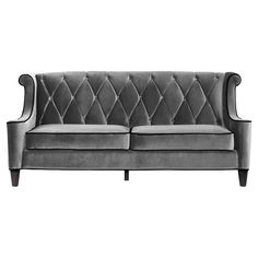 Diamond tufted velvet sofa.Product: Sofa Construction Material: Velvet and wood Color: Gray