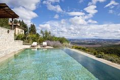 Looking out over the Tuscan countryside from the swimming pool at Villa Oliviera, Castiglion del Bosco