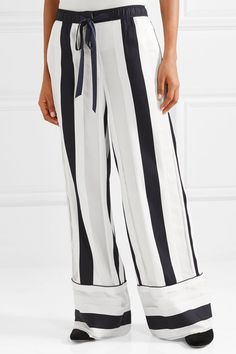 Adam Lippes' Resort '18 collection puts emphasis on beautiful fabrics. Cut from fluid cotton and silk-blend jacquard, these pajama-style pants are spliced with semi-sheer inserts and printed with graphic stripes that emphasize the billowy wide shape. Let the exaggerated cuffs pool to the floor by wearing with flats.