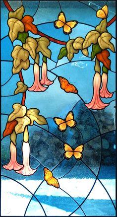 Leaded stained glass door depicting flowers floripondio and butterflies, glass painting by IKO Studio, Orvieto, Italy Porta con vetrata artistica a piombo con fiori di floripondio e farfalle, pittura su vetro a glisaglia e smalti