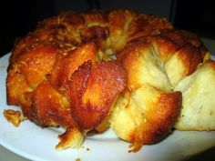 Garlic Parmesan pull-apart Bread – Something easy to bring to a dinner.   Made with 4 ingredients:   1 can of refrigerated Grands biscuits (not the flaky layers)  1/2 stick of butter melted in bundt pan  3 cloves of garlic, minced  1/2 cup grated Parmesan cheese  1 tsp Italian Seasoning   While the butter melts, cut the Grands biscuits into quarters. In a bowl, toss the biscuit pieces, garlic, Italian Seasoning, and Parmesan cheese together. Place in pan with butter   Bake 350 for 20-22…