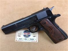 "Love #vintage? This is a beautiful #Colt 1911A1 Commercial, SN: 2417xx-C .45acp 5"", dating the #pistol to #1950 with period correct .22 5"" conversion kit in box. The pistol has all original parts, including the original Colt wood grips. @victoryggw #gun #guitar #texas"