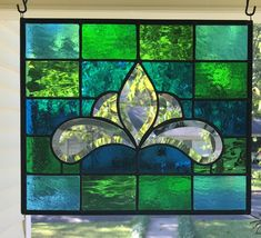 In my East Texas Stained Glass Art Studio. I n stunning turquoise & green tones and textures of stained glass that dazzle in the sunlight, while its beveled center completes it. I have applied a coat of wax and polished it to a shine.   eBay! Stained Glass Christmas, Faux Stained Glass, Stained Glass Lamps, Stained Glass Panels, Stained Glass Projects, Mosaic Glass, Glass Wall Art, Glass Paperweights, Glass Vase