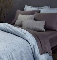 Glacier Blue Bedding - W Hotels. Love the blue with that gray.
