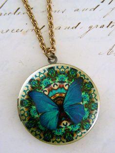Locket Necklace Blue Butterfly Kaleidoscope Retro Vintage Brass. $32.00, via Etsy.