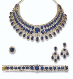 A SAPPHIRE AND DIAMOND SUITE   The necklace designed as two graduated rows of oval-shaped sapphires with brilliant-cut diamond collet spacers and border to the oval-shaped sapphire centre suspending a pear-shaped sapphire fringe to the plain adjustable backchain, bracelet ear pendants and ring en suite, necklace from 36.0 to 44.0 cm long, bracelet 18.0 cm long, ear pendants, 4.7 cm long, ring size 7, in fitted blue velvet case, bracelet in by Eva