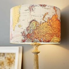 mod podge a map on to a lamp shade. this would be wonderful in my bedroom.