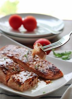 Preheat your oven for a quick and easy baked salmon recipe starring a sweet and tangy glaze made with honey, garlic and soy sauce Honey Salmon, Garlic Salmon, Baked Salmon, Salmon Recipes, Fish Recipes, Seafood Recipes, Cooking Recipes, Fish Dishes, Seafood Dishes