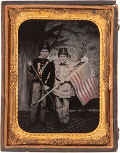 "ca. 1861, gilded, hand colored tintype portrait of two boys ""playing war"", dressed in uniforms and standing in front of a amateurish, painted backdrop"