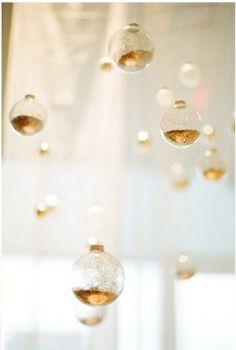 ... clear ornaments filled with gold glitter.