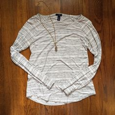 Gap Boyfriend Tee Size small loose fitting boyfriend long sleeve tee with pocket. Like new. GAP Tops Tees - Long Sleeve