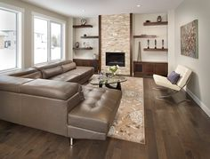Floor to ceiling floating shelves living room contemporary with stone fireplace white trim brown leather sofa