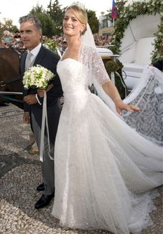 A beaming Tatiana being escorted to the church by her proud stepfather Attilio Brillembourg.