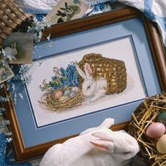 """Easter Bunny Cross Stitch ePattern - Celebrate Easter by stitching this charming bunny design. It's sure to become a treasured family heirloom in your holiday home. Our design was cross stitched over two fabric threads on a 20"""" x 14"""" piece Antique White Lugana (25 count) and custom framed. Number of Designs: 1 Approximate Design Size: 6-1/4""""w x 3-1/8""""h (when stitched over 2 fabric threads on 25 count fabric)Stitch Count: 148w x 77h"""