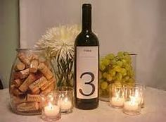 Maybe 2 wine bottles. One with the label and one with the table number @pincredibleone