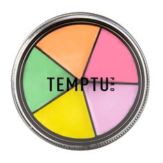 For lighter skin, try Temptu's S/B Neutralizer Wheel, which has a shade for everything—pink brightens sallow undertones, peach covers up hyperpigmentation, yellow hides dark under eye circles, and purple corrects yellow and sallow undertones.