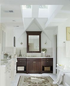Here is my dream home's master bathroom. Skylights for Natural Light!  A Secluded Toilet with Private Door ~ yep, after 36 years of marriage we know what our next bathroom must have! I love the dark wood with the light floors and counter. Marble is a must ~ a jacuzzi tub for two to soak in ~ and lots of counter space! Love the colors and overall spacious feel of this bathroom!