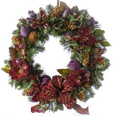 Decorated with a variety of holiday floral including pine, fruit, berries and magnolias. Great for the front door or over a mantel. Features - 24 inch - Made-to-Order In Powell Ohio - Designer Quality