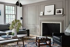 modern-farmhouse-renovation-with-warm-gray-millwork-walls-fireplace