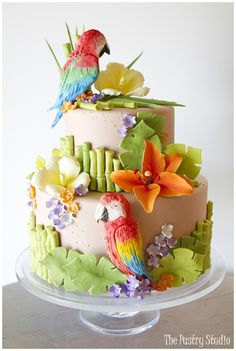 Jimmy Buffet themed Wedding Shower Cake featuring Sugar-Paste Parrots,Tropical Florals and Bamboo. Check out our blog post with more images. http://thepastrystudio.com/blog/