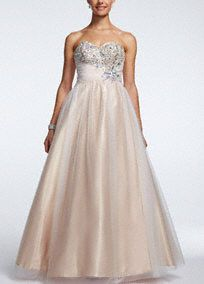 This stunning floor length strapless prom dress is so enchanting Cinderella herself would be jealous!  Strapless sweetheart prom dress features eye-catching asymmetrical sparkling embroidered bodice.  Tulle ball gown adds tons of drama and flare.  Fully lined. Back zip. Imported polyester. Dry clean. Available in Plus sizes as Style DB40W.