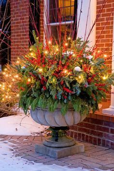 Celebrate the most exciting and cherished holiday of the entire year with Gorgeous Christmas Floral Arrangements that bring nature indoors and set a mood of generosity and appreciation. Christmas Urns, Outdoor Christmas Decorations, Winter Christmas, Christmas Home, Christmas Lights, Christmas Wreaths, Thanksgiving Holiday, Family Holiday, Yard Decorations