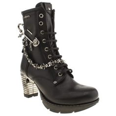 The Pin Chain Boot from New Rock is a sure winner for those who want to stand out from the crowd. The black leather upper is pierced with an oversized safety pin and features skull chain detailing whilst sitting on an 8cm heel and 2cm platform.                                    <br><br><ul><li>Leather upper</li><li>Rubber sole unit</li><li>8cm heel & 2cm platform </li></ul>