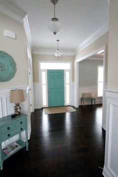 Teal Door Color Carried Through With More Teal Accent Pieces