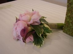 Light pink peonies bridesmaid bouquet mixed with green and white variegated foliage