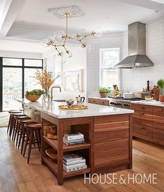 Walnut cabinets coupled with white Calacatta marble create an inviting space for entertaining in this generously-sized kitchen.   Photographer: Donna Griffith   Designer: Sam Sacks