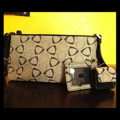 Liz Claiborne handbag Black and grey purse. Like new condition. Says Liz Claiborne on inside tag but not on any of the hardware. Makes me think this one is not authentic. Still cute though. No stains or signs of wear. Comes with ID tag and coin purse. Liz Claiborne Bags