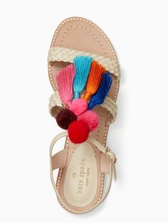 extra, extra: there's a lot to love about these woven leather sandals, topped with a passel of colorful pom-poms and tassels. as easy to wear as they eye-catching, they'll become a staple of your warm-weather wardrobe.