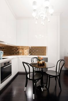contemporary-kitchen-gold-subway-tile-backsplash-black-and-white-modern-renovation-before-after-golden-kitchen-cabinets-accent-lacquer-ikea