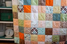 I   LOVE  this  quilt.  It's awful difficult to part with this cheerful, little cutie.  I hope the tiny recipient loves it as much as I do. ...