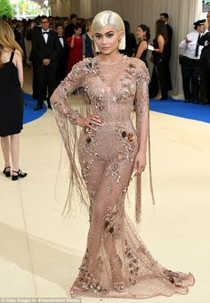 Dare to bare: Perhaps trying to outshine her older half-sister Kylie, 19, flaunted her famous figure in a netted pink Versace number