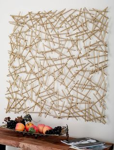 Modern reflections Metal Wall Décor, polished metal finish, decor made of golden iron strips of various sizes welded together to form a web-like abstract design.Our Gold Sticks Metal Wall Plaque is perfect for bringing a little texture to a boring w