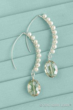 DIY bridal earrings? That's a wrap—literally. Wrap jewelry wire around an angular ear wire a few times. Then string on a pearl, wrap again, add another pearl, and continue. Finish with a glass bead, and ooh la love.
