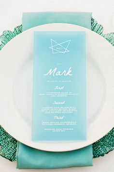 Love the coordination of the menu color, napkin color and charger.