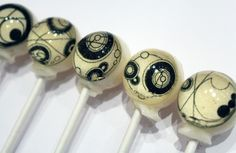 Circular Gallifreyan hard candy lollipops by Vintage Confections
