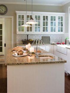 Beadboard on Island, Tile Backsplash, Glass Front Cabinet Doors, Apron Sink, Pocket Door