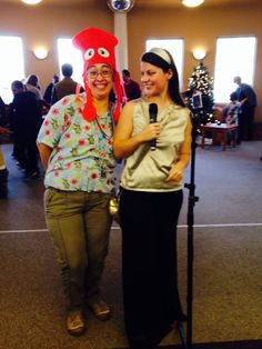 """Storyteller Bethany Geleskie admires a guest's """"Under the Sea""""-themed hat."""