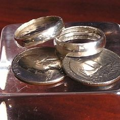 Making a ring out of a quarter. Seems a bit tedious, but -- a nice ring in the end. You'll want to use a silver (1964 or earlier) quarter so you'll have a silver ring!