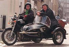 """""""Two Fat Ladies"""" is an unforgettable British cooking show, hosted by these two gals."""