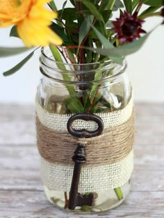 DIY your own centerpieces with a mason jar and an old-fashioned key. http://www.ivillage.com/surprising-uses-mason-jars-around-house/7-a-556047