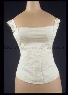 Kent State University Museum: 1983.003.0008 - c1820. white cotton. crossed lacing with external bone/ivory eyelets