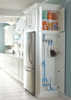 good place to stick some storage - next to fridge! need one of these tall cabinets for cleaning supplies.