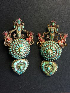 Tibetan ear pieces. Gilt silver, turquoise and gem stones.