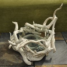 This piece features real, unique segments of driftwood crafted together through hammer and nail to create a decorative, one-of-a-kind bowl. Perfect for lending a natural art touch to your home decor, this bowl was handcrafted in the Philippines.