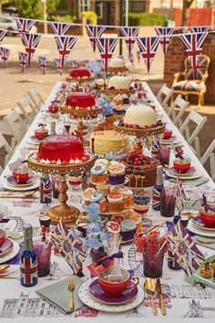 British Street Party Theme | Place Name Setting | Cake Stands | Jelly | Kate Spade Crockery | Gold Cutlery | Plum Glassware | British Colour Palette | Bunting | Union Jack | Traditional | Royal 90th | Luxury Events